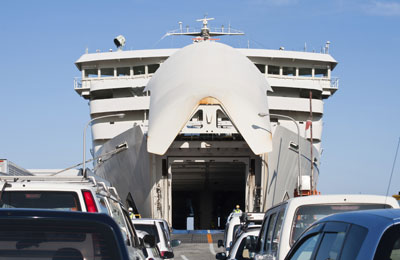 image of cars loading onto a ferry